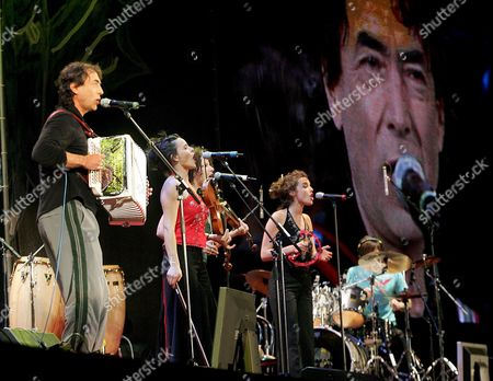 Stock Photo of Austrian Musician Hubert Von Goisern (l) Performs with His Band During the Opening of the Vienna Festival Week 2007 in the Rathausplatz in Vienna Austria 11 May 2007 Hubert Von Goisern who Presented the Evening Played a Number with His New Band and Sang a Duet with Bobby Mcferrin Austria Vienna