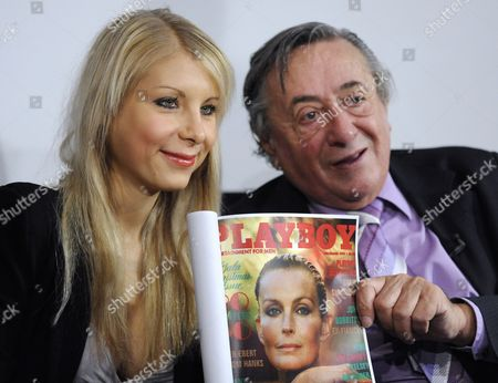 Austrian Businessman Richard Lugner (r) and His Girlfriend Anastasia 'Katzi' Sokol Hold Up a Copy of the Playboy Magazine During the Announcement of Lugner's Star Guest For the Upcoming Vienna Opera Ball at a Press Conference in Vienna Austria 15 February 2011 Lugner's Guest Will Be Us Actress Bo Derek the Vienna Opera Ball Will Take Place on 03 March Austria Vienna