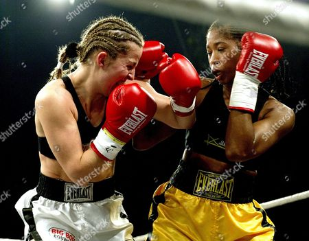 Stock Image of Alicia Ashley of United Staates (r) Exchanges Punches with Dutch Esther Schouten (fighting For Austria) During Their Wibf World Championship Junior Featherweight Fight on Saturday 15 November 2003 in Voesendorf Austria Austria Voesendorf