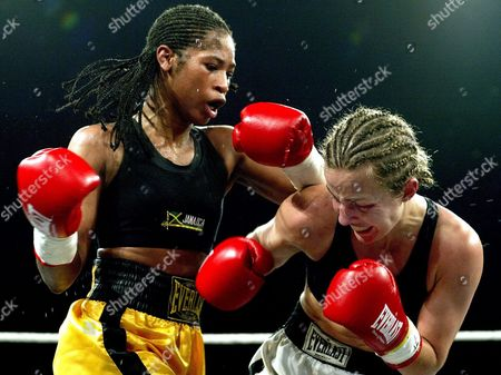 Alicia Ashley of United Staates (l) Exchanges Punches with Dutch Esther Schouten (fighting For Austria) During Their Wibf World Championship Junior Featherweight Fight on Saturday 15 November 2003 in Voesendorf Austria Austria Voesendorf