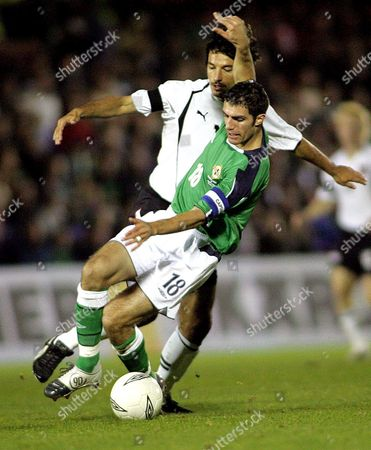 Ivica Vastic of Austria Challenges Aaron Hughes of Northern Ireland During Their World Cup Qualifying Match in Windsor Park Belfast Northern Ireland on Wednesday 13 October 2004 United Kingdom Belfast