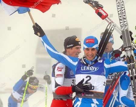 Jason Lamy Chappuis (c-r) of France is Congratulated by Austria's Felix Gottwald (c-l) After Winning the Nordic Combined Individual Large Hill / Gundersen Competition at the Fis Nordic Skiing World Championships 2011 in the Holmenkollen Ski Arena in Oslo Norway 02 March 2011 Norway Oslo