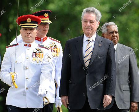 Austrian Federal President Heinz Fischer (c) and the President of the Republic of Singapore Sr Nathan (r) Pass the Guard of Honor During a Welcoming Ceremony Singapore on 21 February 2011 President Fischer Stays For a Two-day Official Vist in Singapore Singapore Singapore