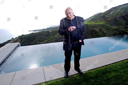A Picture Dated 05 March 2010 Shows Austrian Cinematographer Christian Berger Posing For Photographs As He Visits Austrian Director Robert Dornhelm (not Pictured) in Malibu California Usa 05 March 2010 Christian Berger is a Nominee For the Best Cinematography Award For the Movie 'The White Ribbon' by Michael Haneke at the 82nd Annual Academy Awards Which Take Place in Los Angeles on 07 March 2010 United States Malibu
