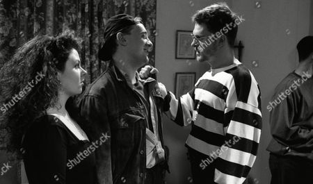 Nicola Strong (as Lorraine Nelson), Tony Pitts (as Archie Brooks), at Lorraine's party as William G Travis (as Del) and Mark Hamer (as Pete) cause trouble. (Ep 1734 - 28th January 1993)