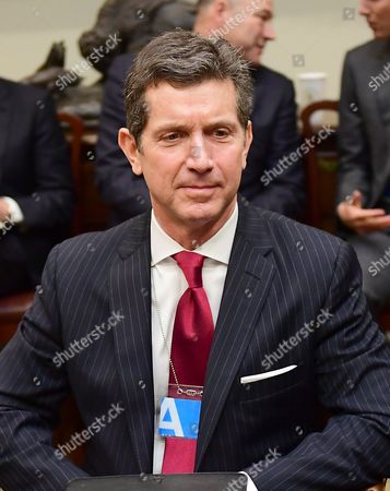 Alex Gorsky of Johnson & Johnson listens as United States President Donald Trump makes remarks at a breakfast and listening session with key business leaders in the Roosevelt Room of the White House in Washington, DC.