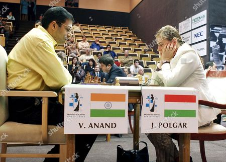 Bishwanathan Anand (l) From India and Judit Polgar (r) From Hungary Studie the Chess Board During Their Chess Game in the First Round of the Chess World Championship in Potrero De Los Funes San Luis Province Argentina Wednesday 28 September 2005 Players From Uzbekistan England Hungary India Bulgaria and Russia Will Take Part in the First Round of the Chess World Championship the Championship Will Be Held From September 28 to October 15 Argentina Buenos Aires