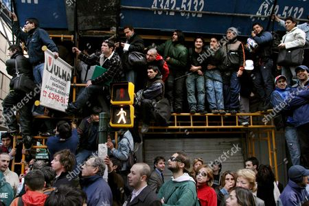 Stock Photo of Argentinians Wait in Vain in the Center of Buenos Aires For Top Model Nicole Neumann to Take Her Clothes Off in Public One of the Highlights of a Protest by Models 29 August 2007 Against the Use of Fur and the Indiscriminate Hunting of Animals For Commercial Purposes Neumann Could not Make the Appointment Argentina Buenos Aires