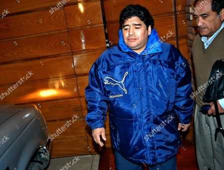 Former Argentinian Soccer Star Diego Armando Maradona (l) is Flanked by an Official As He Leaves the House of His Ex-wife Claudia Villafane in Buenos Aires on Wednesday 08 September 2004 Maradona Postponed For One Week His Trip to Cuba to Receive Attention For His Addiction to Drugs Local Press Said Wednesday Maradona Cancelled the Airfare Ticket That Would Take Him to the Island Because the Authorization by the Argentine Justice For Him to Leave the Country is not Firm Yet Said Sources Close to the Former Super Star Argentina Buenos Aires