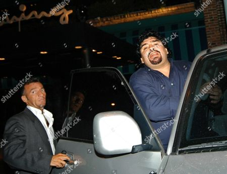 Argentine Soccer Star Diego Maradona (r) Leaves a Buenos Aires Restaurant Early Tuesday Morning 07 December 2004 After Attending a Television Show where He was Interviewed by the Show's Host Marcelo Tinelli Maradona Returned to Argentina on Sunday From Cuba where He is Undergoing Drug Rehabilitation Argentina Buenos Aires