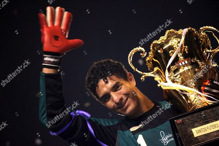 Santos Golkeeper and Captain Fabio Costa Holds the Paulist Championship Trophy After Defeating Sao Caetano in the Final Match at Cicero Pompeu De Toledo Stadium in Sao Paulo Brazil 06 May 2007 Brazil Sao Paulo