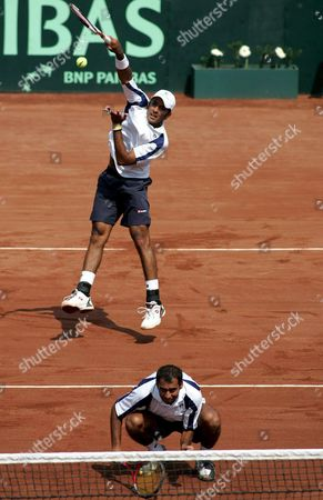 Stock Picture of Pakistani Tennis Doubles Team Aqeel Khan (down) and Aisam Qureshi in Action Against the Chilean Team During Their Davis Cup Match on Saturday 24 September 2005 in Santiago De Chile Chile Santiago De Chile
