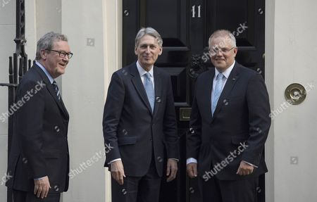 British Chancellor of the Exchequer Philip Hammond (C) greets Australian Treasurer Scott Morrison (R) and Australian High Commissioner to the United Kingdom Alexander Downer (L) on the steps of No11 Downing Street, Central London, Britain, 24 January 2017. The Supreme Court ruled against British Prime Minister Theresa May government forcing the Prime Minister to seek parliaments approval before triggering Article 50 to make the United Kingdom leave the EU.