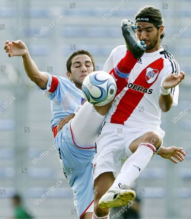 Uruguayan Soccer Player From River Plate Sebastißn Abreu (r) Fights For the Ball with Arsenal De Sarandi Carlos Casteglione (l) During the Eight Day of the Argentinean Clausura Tournament Match on 30 March 2008 at the Jose Amalfitani Stadium Buenos Aires Argentina Argentina Buenos Aires