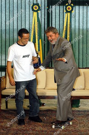 Brazilian President Luiz Inßcio Lula Da Silva (r) Shares a Laugh with Sandro Dias (l) World Skate Champion 2003 While Balancing on a Skateboard Monday 22 December 2003 at the Presidential Palace of Planalto Brasilia (brazil) This is the First Time That a Brazilian President Meets with a Skater Brazil Brasilia