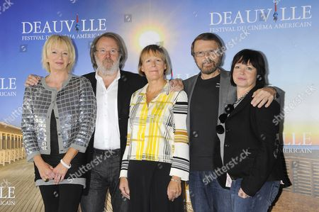 Bjorn Ulvaeus and Benny Anderson of the Swedish group Abba pose with producer Judy Cramer (L) ,director Phyllida Lloyd (C) and British playwright Catherine Johnson (R)