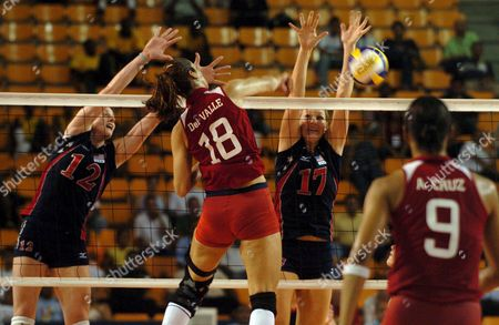Jetzabel Del Valle (18) of Puerto Rico's Volleyball Team Strikes the Ball Against the Block of Nancy Metcalf (12) and Jennifer Joines (17) of Usa During the Match That Usa Won During the Quarter Finals of the 4th Women's Pan American Volleyball Cup Held at Santo Domingo Dominicana Republic Thursday 16 of June 2005 Dominican Republic Santo Domingo