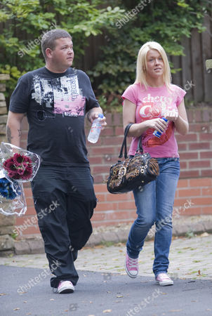 Stock Image of Natalie and Stephen Rooney, cousins of Wayne Rooney, deliver flowers  to the home of Kerry Katona who is celebrating her birthday today.