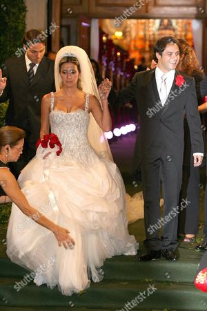 Newly-wed Brazilian Formula One Champion Felipe Massa (r) and Stylist Anna Rafaela Bassi (l) Leave the Nuestra Senora De Brazil Church in Sao Paulo Brazil After Their Marriage 30 November 2007 Massa's New Contract with Ferrari Will See Him Remain at the Team Until the End of the 2010 Season Media Reported Brazil Sao Paulo
