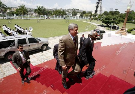Canadian Prime Minister Stephen Harper Arrives at the National Palace in Port-au-prince Haiti 20 July 2007 During a Visit the Country in Which He Pledged His Continuing Support For the Caribbean Country One of the Largest Beneficiarias of Canadian Aid After Afghanistan Harper was Greeted by Haitian Dignitaries Including Haitian President Rene Garcia Preval Haiti Port Au Prince