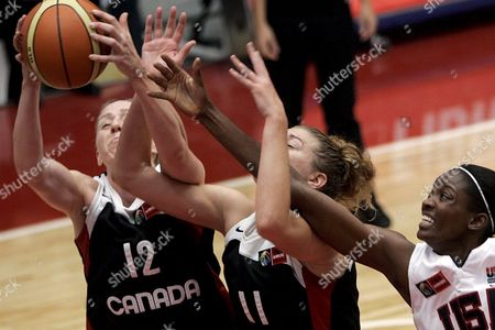 Us Basketball Player Candance Parker (r) Fights For the Ball with Canadians Amanda Brown (c) and Lizanne Murphy (l) During the Women's Fiba Americas Championships 28 September 2007 in Valdivia Some 840 Km South of the Capital Santiago Chile Chile Valdivia