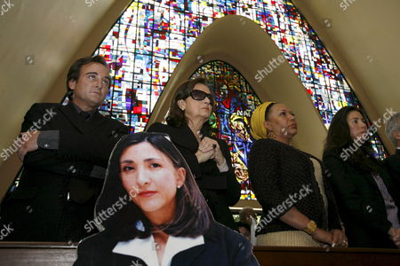 Juan Carlos Lecompte (l) Yolanda Pulecio (2-l) and Astrid Betancourt (r) Husband Mother and Sister of Colombian Former Presidency Canditate Ingrid Betancourt Joined by Colombian Congresswoman Piedad Cordoba (2-r) During a Mass in Bogota Colombia 23 February 2008 to Mark the Sixth Anniversary of Betancourt's Abduction by the Revolutionary Armed Forces of Colombia (farc) Betancourt who Also Holds French Citizenship was Kidnapped on 23 February 2002 on a Highway Going to Caguan Province of Caqueta Colombia That was Blocked by Rebels of the Main Colombian Guerrilla Colombia Bogota