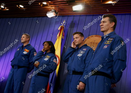 Stock Photo of Space Shuttle Discovery Crew Members (l-r) George D Zamka Whose Mother is Colombian Us Stephanie D Wilson Us Douglas H Wheelock and Italian Paolo Angelo Nespoli During a Press Conference at the Casa De Narino House of Colombian Government After a Meeting with the President Alvaro Uribe Velez in Bogota Colombia 04 March 2008 As Part of a Visit to the Country in Which They Will Give Conferences in Several Cities About Their Experience Working in the Space Colombia Bogota