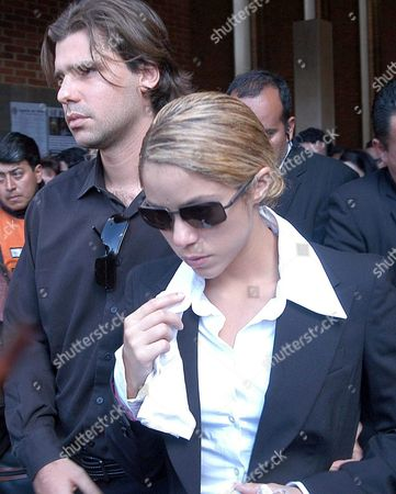 Colombian Singer-songwriter Shakira (r) with Her Boyfriend Antonio De La Rua (l) During the Burial Ceremony of Patricia Tellez Shakira's Manager in Colombia at Bogotß Colombia Wednesday 18 August 2004 Tellez was Found Dead in Her Appartment Local Media Said That She Suffered a Heart Attack Colombia Bogotß