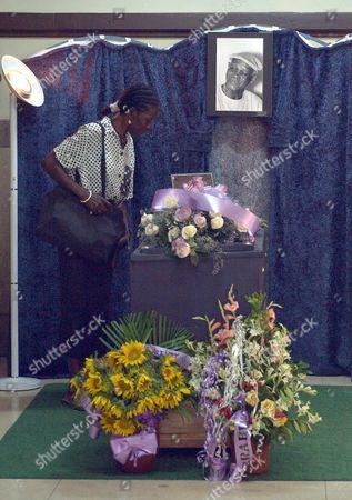 A Woman Sunday 07 August 2005 Stands Over the Coffin of Cuban Singer Ibrahim Ferrer Member of the Grammy Award-winning Group the Buenavista Social Club Ferrer 78 Died Saturday in Havana Cuba Cuba Havana