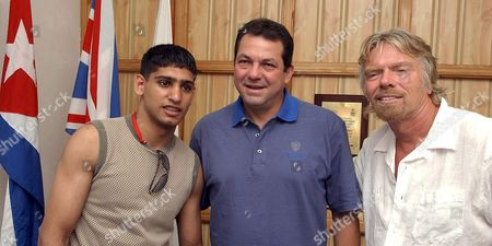 Stock Picture of Virgin Atlantic's President Richard Branson (r) Poses with British Boxer Amir Kahn (l) and the President of the Cuban Sports National Institute Humberto Rodriguez (c) During a Visit to the Institution Tuesday 28 June 2005 in Havana Cuba Branson and Kahn Arrived in Cuba on Monday on the First Flight to Havana of Virgin Atlantic Cuba Havana