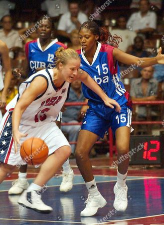 Lindsay Taylor United States (l) Tries Driving Around Cuban Defender Yuliami Rodr?guez During a Friendly Basketball Game Between Eeuu-cuba Played Tuesday 22 July 2003 the Two Women Squads Squared Off in a Friendly Game Preparation For Their Olympic Qualification Epa Photo/efe/alejandro Ernesto Cuba La Habana