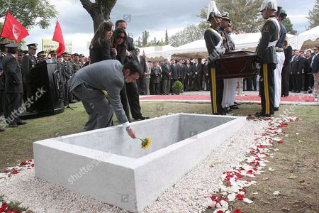 Ricardo Avila Larriva (l) Son of the Ecuadorian Minister of Defense Guadalupe Larriva Leaves a Flower in the Grave During the Burial of His Mother Larriva Died Last Wednesday 24 January 2007 in a Helicopter Crash in Manabi County in Which Also Died Her Daughter Claudia 17 Year Old Guadalupe Larriva and Her Daugther Claudia Were Buried Friday 26 January 2007 with Military Honors in Cuenca Their Birth City Ecuador Cuenca
