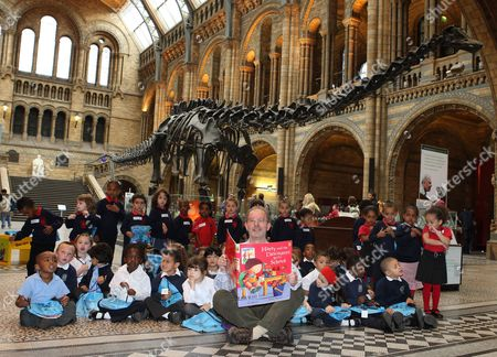 Editorial image of Ian Whybrow reads to children from his book 'Harry and The Dinosaurs go to School' in the Great Hall at the Natural History Museum, London, Britain - 09 Sep 2008