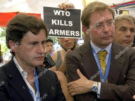Italian Minister of Agriculture Gianni Alemanno (l) and Italian Deputy Minister of For Productive Activities Adolfo Urso (r) Listen to a Petition by Mexican Farmers As They Arrived For the Final Sessions on the Last Day of Wto Meeting in Cancun Sunday 14 September 2003 Epa Photo/efe/lucio Blanco// Mexico Cancun