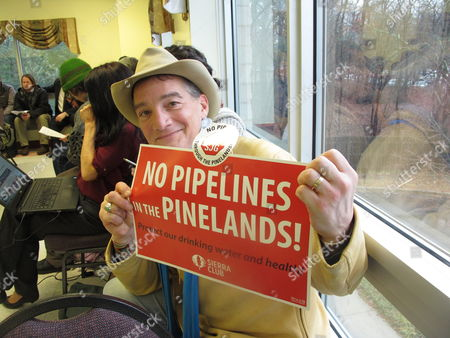 Dan Bailiff, a member of the New Jersey Sierra Club, holds a sign indicating his opposition to a natural gas pipeline proposed to run through the federally protected Pinelands preserve in New Jersey during a public hearing on the proposal in Pemberton, N.J. on . Environmentalists fear the pipeline will damage the fragile forest, but business and labor groups say it will create jobs and increase energy reliability