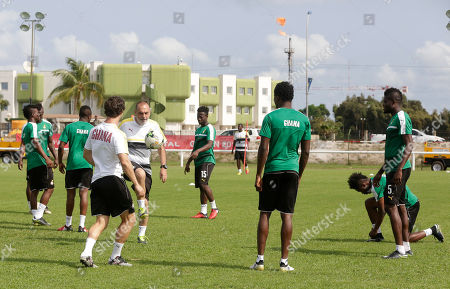 Ghana's, soccer Coach, Avram Grant, centre left, controls the ball during a training session at the Stade de Sogara in Port-Gentil, Gabon, ahead of their African Cup of Nations Group D soccer match against Egypt