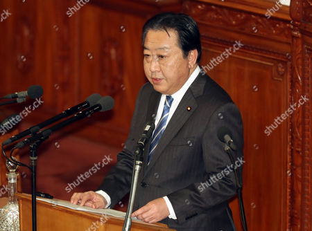 Japan's main opposition Democratic Party Secretary General Yoshihiko Noda questions to Prime Minister Shinzo Abe for Abe's policy speech at the Lower House's plenary session at the National Diet in Tokyo