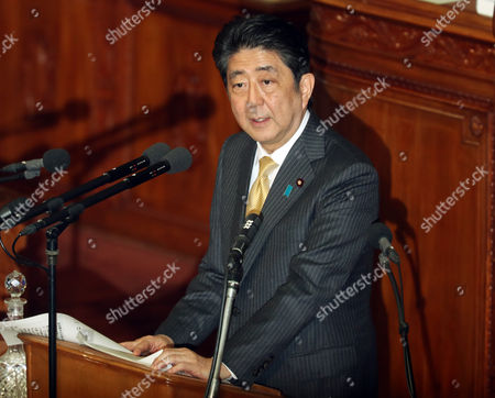 Japanese Prime Minister Shinzo Abe answers questions by the main opposition Democratic Party Secretary General Yoshihiko Noda for Abe's policy speech at the Lower House's plenary session at the National Diet in Tokyo