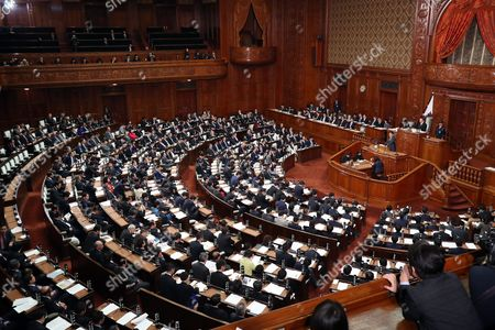 Stock Image of Japanese Prime Minister Shinzo Abe answers questions by the main opposition Democratic Party Secretary General Yoshihiko Noda for Abe's policy speech at the Lower House's plenary session at the National Diet in Tokyo
