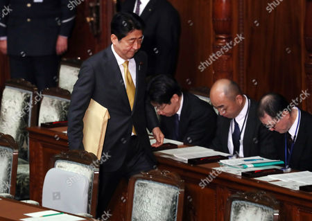 Stock Photo of Japanese Prime Minister Shinzo Abe arrives at the Lower House's plenary session to answer questions by the main opposition Democratic Party Secretary General Yoshihiko Noda for Abe's policy speech at the National Diet in Tokyo