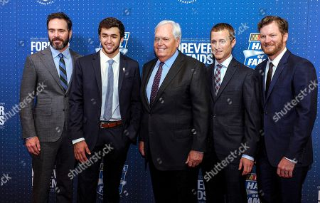 Jimmie Johnson, Chase Elliott, Rick Hendrick, Kasey Kahne, Dale Earnhardt Jr NASCAR Hall of Fame inductee and team owner Rick Hendrick, center, poses with his drivers from left, Jimmie Johnson, Chase Elliott, Kasey Kahne, and Dale Earnhardt Jr. on the red carpet before the NASCAR Hall of Fame Induction ceremony in Charlotte, N.C