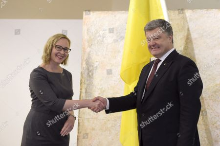 The Speaker of the Finnish Parliament Maria Lohela (left) and Ukraine's President Petro Poroshenko shaking hands while meeting at the Parliament in Helsinki