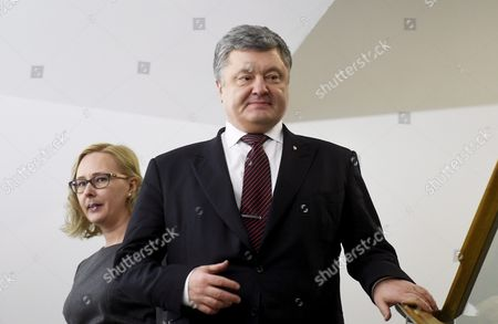 Ukraine's President Petro Poroshenko tours the Finnish Parliament with the Speaker of the Finnish Parliament Maria Lohela (L) during his one-day visit to Finland in Helsinki
