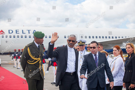Stock Image of V CELAC Summit Escorted by Dominican Foreign Office Ambassador Pedro Gómez, wearing dark glasses, Guyana's President David Arthur Granger, second left, arrives at the Punta Cana International airport to attend the V Summit of the Community of Latin American and Caribbean States, CELAC, in Bavaro, Dominican Republic