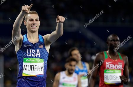 United States' Clayton Murphy, left, reacts after placing second in a men's 800-meter semifinal in the athletics competitions of the 2016 Summer Olympics at the Olympic stadium in Rio de Janeiro, Brazil. Two-time defending champion Shannon Rowbury and Olympian Clayton Murphy will run in the Wanamaker Mile at next month's Millrose Games. New York Road Runners said, they'll compete Feb. 11 at The Armory in the 110th running of the event