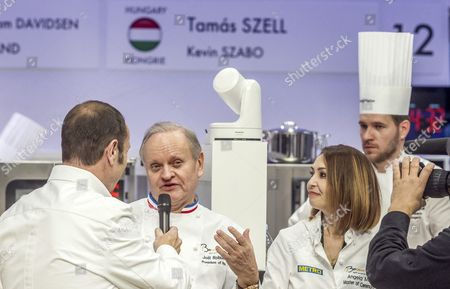 Honorary President of the Jury Joel Robuchon (C) is seen interviewed in front of the kitchen of Hungarian chef Tamas Szell during the first day competition of the two-day world final of the Bocuse d?Or contest at the Sirha International Hotel Catering and Food trade Exhibition, in Lyon, France, 24 January 2017.