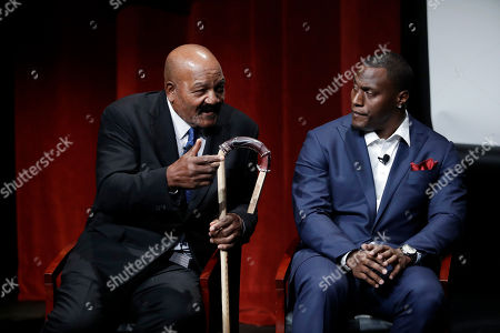 """Jim Brown, Takeo Spikes Former NFL football players Jim Brown, left, and Takeo Spikes participate in a sports and activism panel entitled """"From Protest to Progress: Next Steps"""", in San Jose, Calif"""