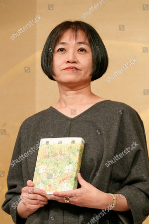 Riku Onda with her book 'Honey Bee and Distant Thunder'
