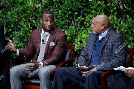 """NFL football wide receiver Anquan Boldin, left, and former U.S. Olympian Tommie Smith during a sports and activism panel entitled """"From Protest to Progress: Next Steps"""", in San Jose, Calif"""