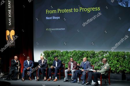 """Former and current professional athletes, from left, Jim Brown, Takeo Spikes, Kareem Abdul-Jabbar, Chris Webber, Anquan Boldin and Tommie Smith alongside Dr. Harry Edwards, participate in a sports and activism panel entitled """"From Protest to Progress: Next Steps"""", in San Jose, Calif"""